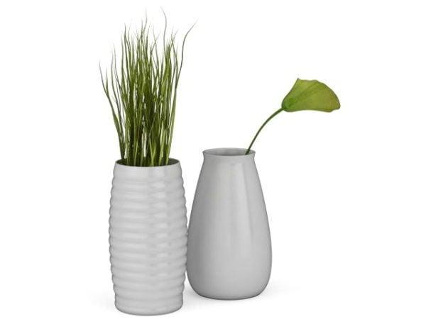 Kasvit valkoisessa maljakossa