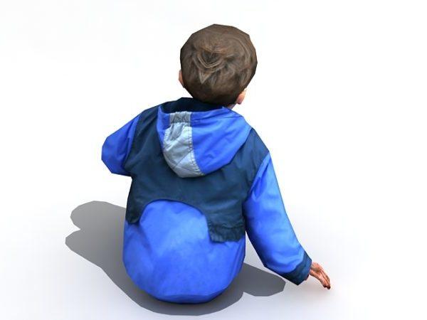 صبي يجلس على الأرض