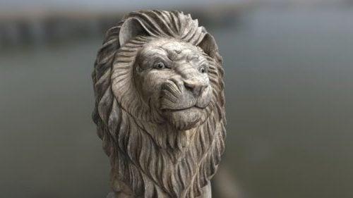 Puinen leijonanveistos