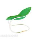 Zielone, minimalistyczne krzesło codzienne