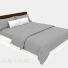 Coperta grigia del letto di legno dell'hotel