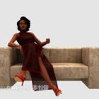 ソファの椅子の美しさのドレスの女の子