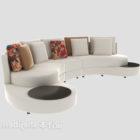 Böjd vit soffa med kuddar