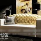 Złota sofa Chesterfield w stylu antycznym